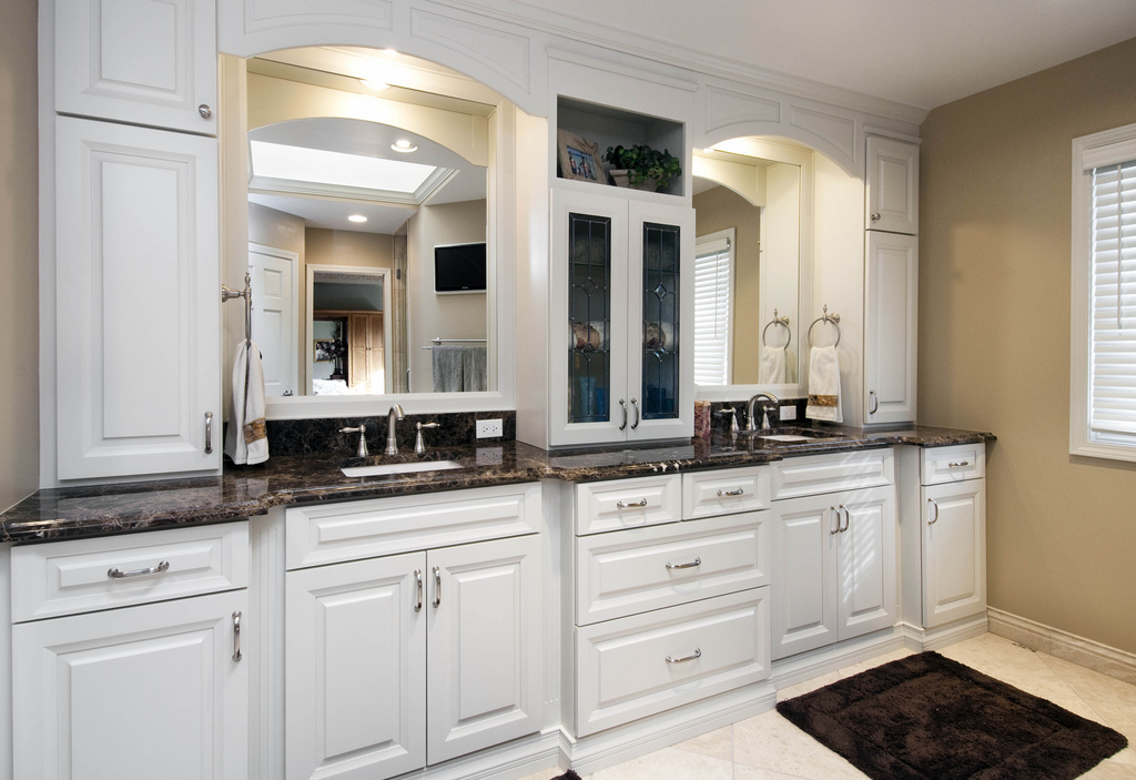 black-marble-on-white-raised-panel-cabinets