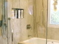 beige-granite-slab-shower-and-tub