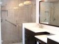 beige-tile-with-diamond-border-ivory-granite-on-raised-panel-cabinetry