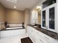 black-marble-on-white-raised-panel-cabinets-2