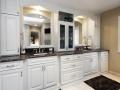 black-marble-on-white-raised-panel-cabinets