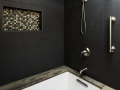 black-surround-with-tan-granite-tub-deck