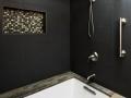 black-surround-with-tan-granite-tub-deck
