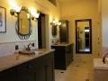 brown-granite-on-black-mission-cabinets
