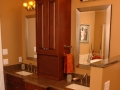 dbl-sink-brown-granite-on-brown-raised-panel-cabinets