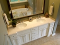 white-solid-surface-on-white-flat-panel-cabinets