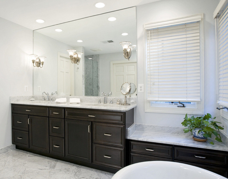 white-marble-on-brown-raised-panel-cabinets