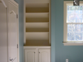 built-in-cabinetry-with-concealed-laudry-shoot-access